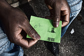 A migrant holds on October 21 2014 his only form of identification that allows him access to the Traiskirchen asylum center situated 20 miles south...