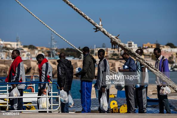 Migrant men board a ship bound for Sicily on April 22 2015 in Lampedusa Italy Migrants continue to arrive in Lampedusa from North Africa taking...