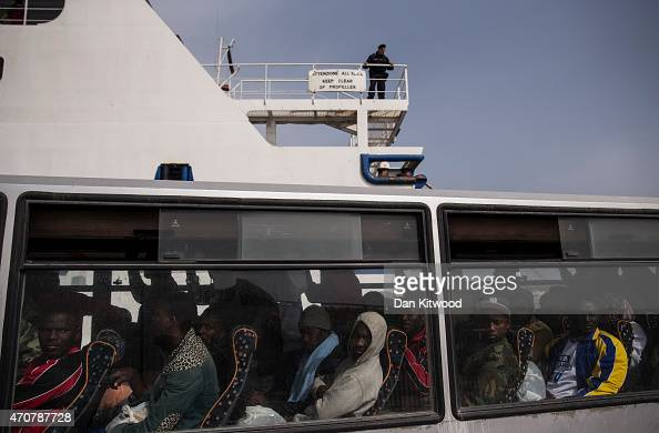 Migrant men wait on a bus before boarding a ship bound for Sicily on April 23 2015 in Lampedusa Italy It is expected that EU leaders in Brussels are...