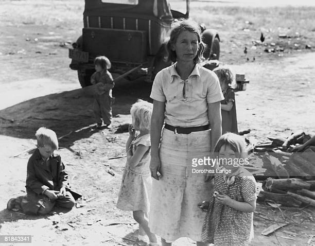 A migrant mother of five from Oklahoma who has found work picking cotton near Fresno California November 1936