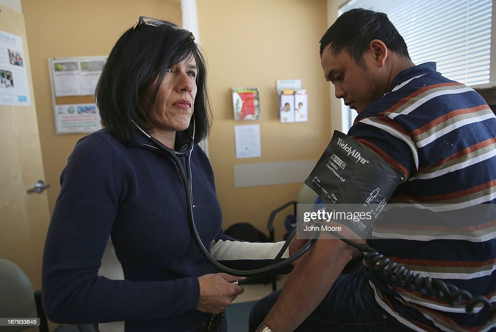 Migrant outreach coordinator Jessica Perez del Olmo checks the blood pressure of an asylum immigrant from Myanmar at the Salud Family Health Clinic on May 2, 2013 in Fort Collins, Colorado. The non-profit provides health services to asylum immigrants as well as migrant farm workers, many of whom have no other access to healthcare, throughout northeastern Colorado. Healthcare for immigrants has become a major issue in immigration reform proposals.