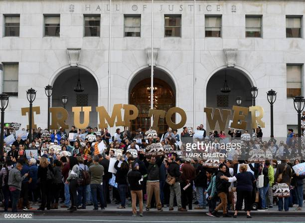 TOPSHOT Migrant rights protesters demonstrate outside the Hall of Justice against the use of state police resources for federal immigration...