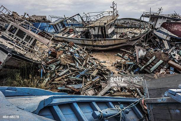 A migrant ship graveyard on September 8 2014 in Lampedusa Italy In the early days of mass migration from North Africa Italian authorities would tow...