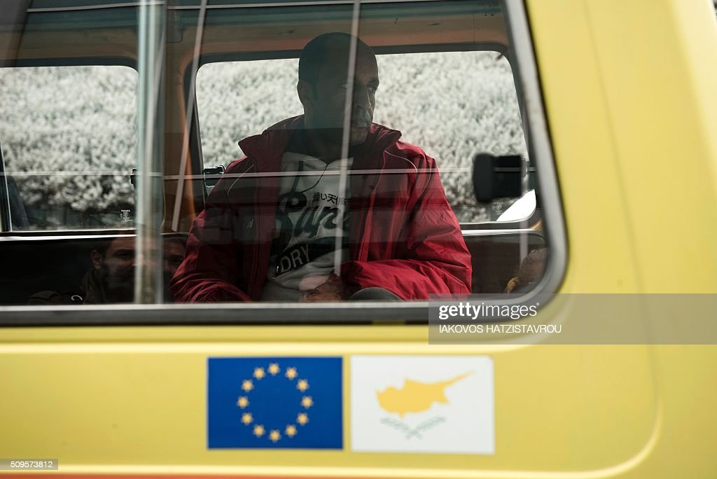 A migrant sits inside a vehicle at the International airport in the Cypriot southeastern port city of Larnaca on February 11, 2016 upon his arrival from Greece alongside five other people as part of the European Union's efforts and its Member States to manage Greece's immigration crisis. Cyprus welcomed the first group of people, in the context of the implementing of a program of relocation of beneficiaries of protection from Greece, consistent with its commitments through the Member States facing disproportionate migratory pressures. / AFP / Iakovos Hatzistavrou