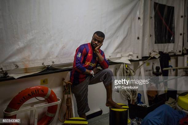 migrant stands on the deck of the Aquarius rescue ship run by NGO SOS Mediterranee and Medecins Sans Frontieres after his transfer from the NGO...