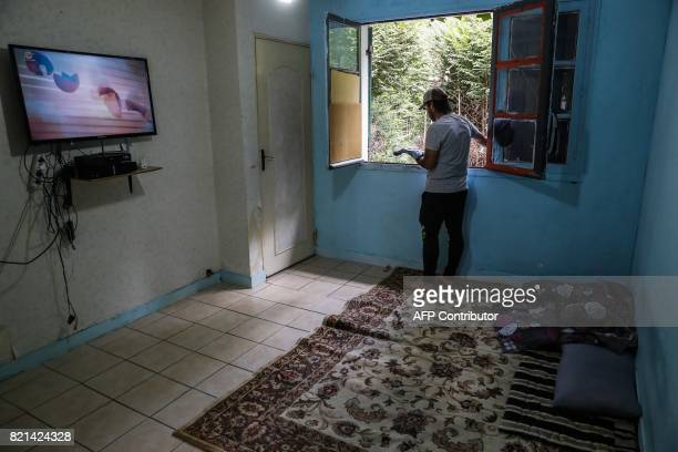 A migrant threatened of eviction is pictured on July 20 2017 in a house he lives in since 2015 at the former Cite de l'Air housing estate in...