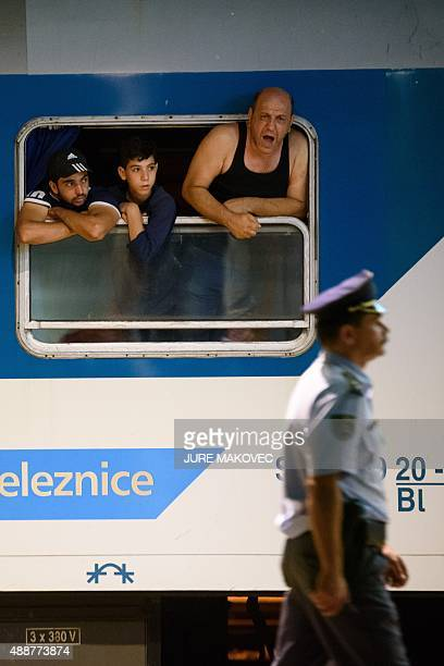 A migrant waiting in a train at the railway station near the SlovenianCroatian border in Dobova Brezice yells at a police officer on September 17...