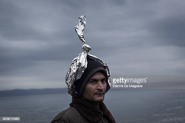 A migrant walks to a transit camp after he landed on a rubber boat on the shores of Lesbos on January 5 2015 near Skala Sikaminias Greece Lesbos the...