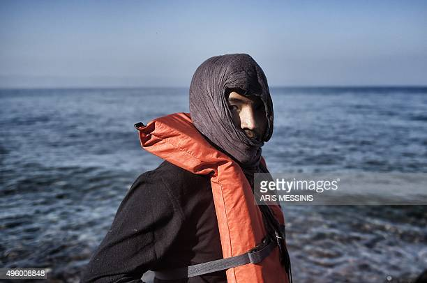 A migrant wearing a lifejacket arrives on the Greek island of Lesbos after crossing the Aegean Sea from Turkey on November 6 2015 Lesbos lies on the...
