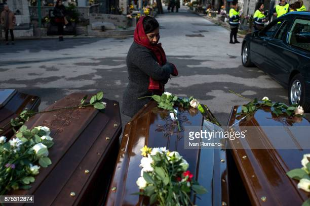 A migrant woman pays tribute to the bars of the migrant women in the Monumental Cemetery on November 17 2017 in Salerno Italy A funeral was held for...