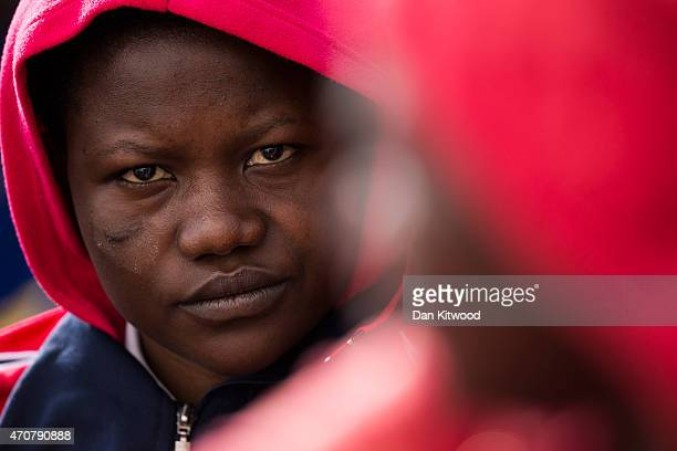 A migrant woman waits to board a ship bound for Sicily on April 23 2015 in Lampedusa Italy It is expected that EU leaders in Brussels are to agree...