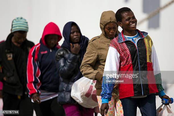 Migrant women board a ship bound for Sicily on April 23 2015 in Lampedusa Italy It is expected that EU leaders in Brussels are to agree later that...