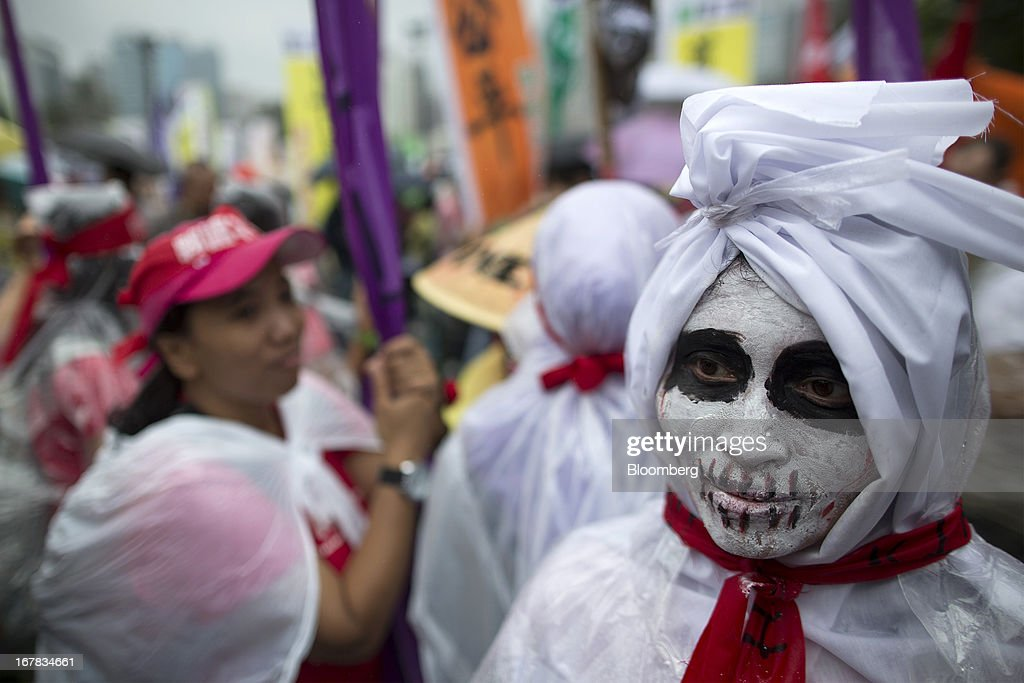 A migrant worker is made up as a skull during a Labor Day march in Hong Kong, China, on Wednesday, May 1, 2013. Thousands of Hong Kong residents took to the streets today for Labor Day marches to petition for better labor conditions and in support of strike action by workers at docks operated by billionaire Li Ka-shing. Photographer: Jerome Favre/Bloomberg via Getty Images