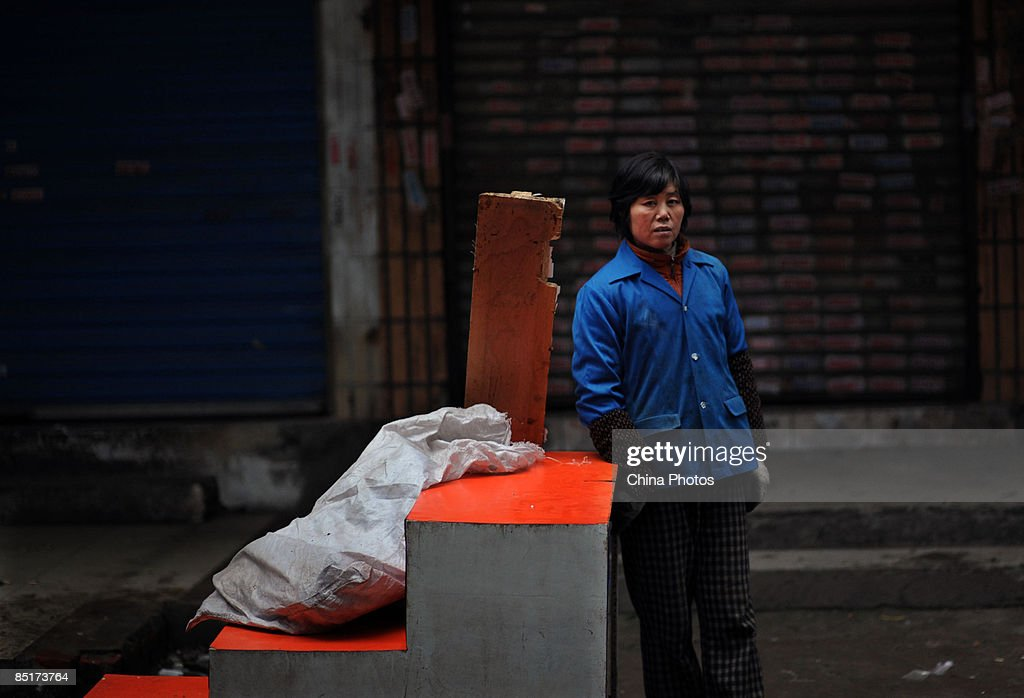 A migrant worker picks garbage at a street on March 1, 2009 in Wuhan of Hubei Province, China. China is facing a difficult employment situation in 2009 as the global financial crisis impacts on the country's economy. According to the Ministry of Human Resources and Social Security, China's urban registered unemployment rate climbed to 4.2 percent in December 2008, its highest level in 5 years, with an estimated 20 million migrant workers reported to have lost their jobs due to the shutdown of factories which produce goods for export.