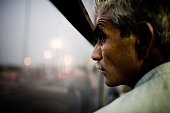 A migrant worker sits in a bus returning him to the labor camps located outside the city after a day of work July 11 2008 in Dubai United Arab...