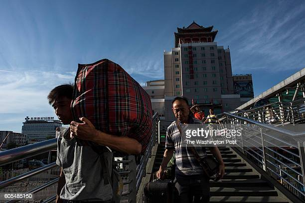 BEIJING CHINA MAY 26 Migrant workers and travelers depart and arrive at the Beijing West Railway Station in Beijing on May 26 2016 Migrant workers...