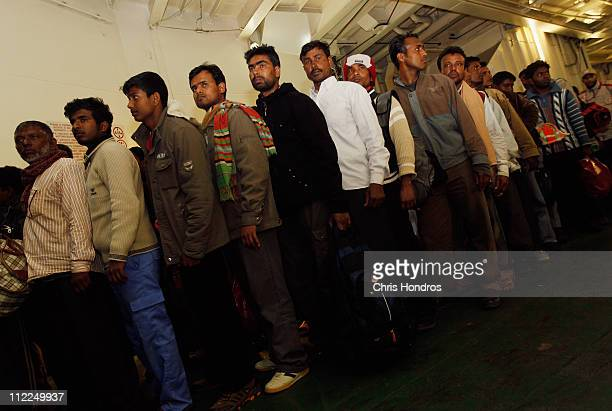 Migrant workers stand in line waiting to disembark a ship that evacuated them from the besieged city of Misrata April 15 2011 in Benghazi Libya...