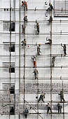 Migrant Workers Work At A Construction Site
