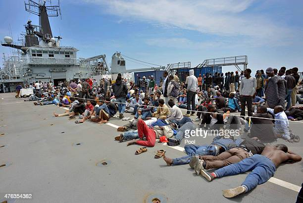 Migrants aboard HMS Bulwark having been rescued by Royal Marines following their attempt to reach Italy by boat from Libya on June 8 2015 in transit...