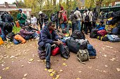 Migrants and asylum seekers mostly from Sudan wait for a bus outside the subprefecture of the northern French port of Calais after leaving the...