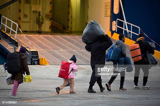 Migrants and Refugee from Afghanistan and Syria stand in line at the Port of Mytelene while boarding a ferry which will bring 500 refugees to Athens...
