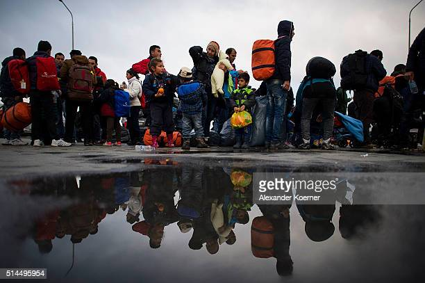Migrants and Refugee from Afghanistan and Syria stand in line at the Port of Mytelene prior boarding a ferry which will bring 500 refugees to Athens...
