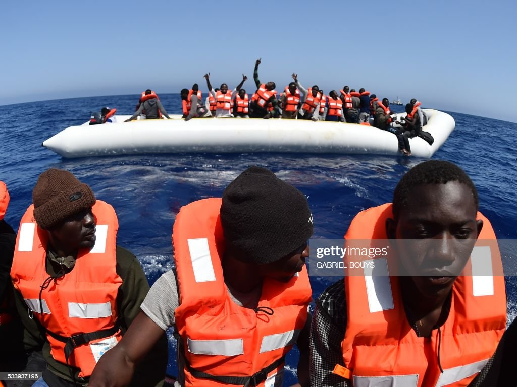 Migrants and refugees are rescued during an operation at sea with the Aquarius, a former North Atlantic fisheries protection ship now used by humanitarians SOS Mediterranee and Medecins Sans Frontieres (Doctors without Borders), on May 24, 2016 in the Mediterranean sea in front of the Libyan coast. / AFP / GABRIEL