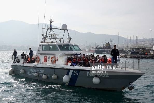 Migrants and refugees arrive on the ship of Hellenic coast guard at the port of Lesbos island on January 31 2016 More than one million people reached...