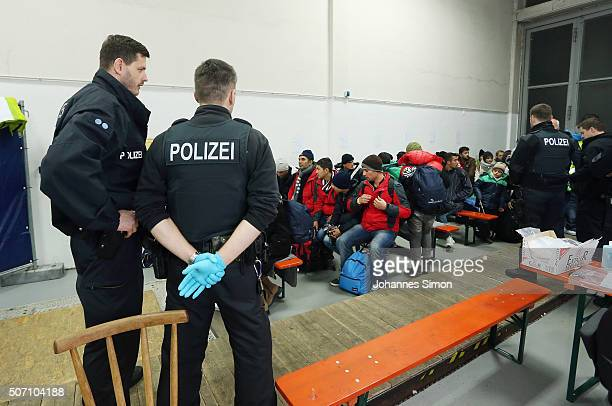 Migrants and refugees arriving from Austria wait to be registered at a processing center on January 27 2016 in Passau Germany The flow of migrants...