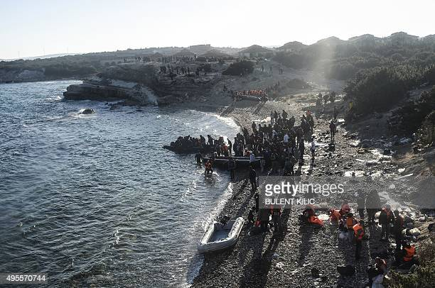 Migrants and refugees begin to board dinghies to travel to the Greek island of Chios from Cesme in the Turkish province of Izmir on November 4 2015...
