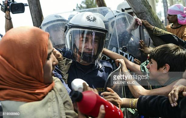 Migrants and refugees clash with riot police during a protest to call for the reopening of the borders at their makeshift camp in the northern border...