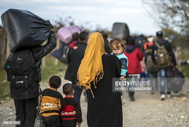 Migrants and refugees cross the GreekMacedonian border near Gevgelija on November 10 2015 More than 3000 refugees and migrants have drowned among the...