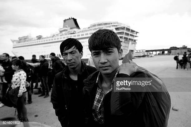 Migrants and refugees from Syria Afganistan and Iraq disembark from the governmentchartered ferry quotEl Venizelosquot at Piraeus port Athens...