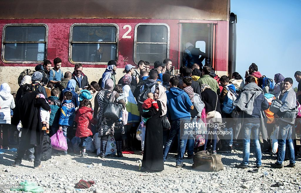 Migrants and refugees prepare to board a train heading to Serbia from the MacedonianGreek border near Gevgelija on October 25 2015 European Union and...
