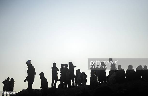 Migrants and refugees prepare to leave via raft to the Greek island of Chios from Cesme in the Turkish province of Izmir on November 5 2015 Up to...