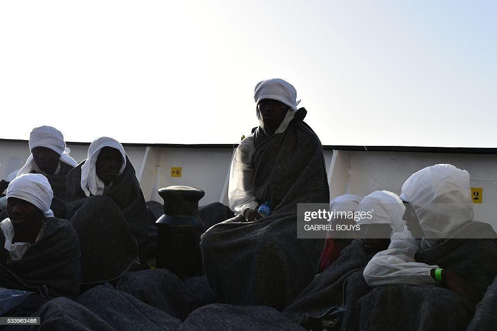 Migrants and refugees prepare to sleep aboard the rescue ship 'Aquarius', on May 24, 2016 after a rescue operation in front of the Libyan coast. The Aquarius is a former North Atlantic fisheries protection ship now used by humanitarians SOS Mediterranee and Medecins Sans Frontieres (Doctors without Borders) which patrols to rescue migrants and refugees trying to reach Europe crossing the Mediterranean sea aboard rubber boats or old fishing boat. / AFP / GABRIEL