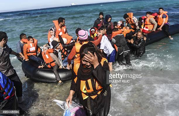 Migrants and refugees return to the shore of Cesme in the Turkish province of Izmir after winds halted their journey to the Greek island of Chios on...