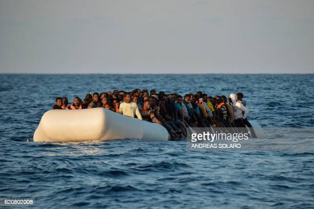 TOPSHOT Migrants and refugees sit on a rubber boat before to be rescued by the ship Topaz Responder run by Maltese NGO Moas and Italian Red Cross off...