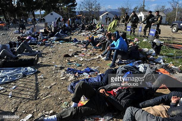 Migrants and refugees sleep as they wait to cross the border of Greece and Macedonia near Idomeni on November 23 2015 Serbia and Macedonia which lie...