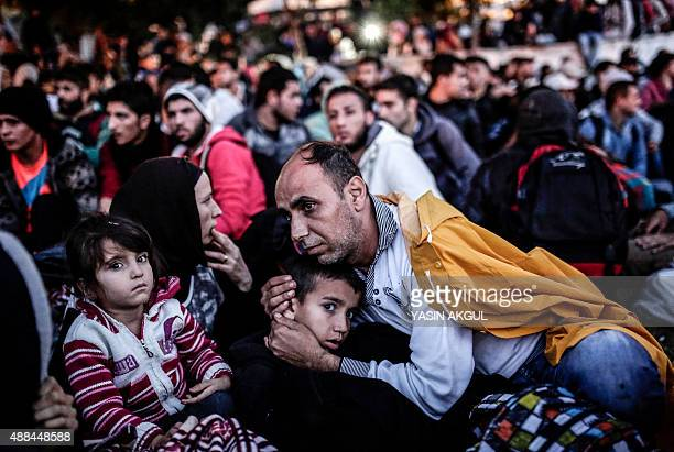 Migrants and refugees wait at Istanbul's Esenler Bus Terminal for buses to the TurkishGreek border after authorities withheld tickets to Turkish...