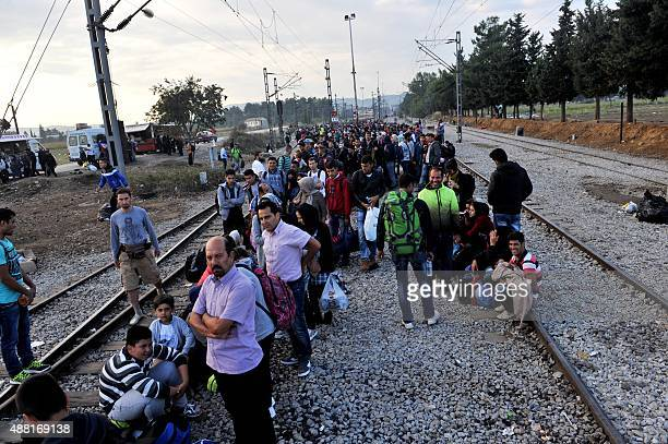 Migrants and refugees wait to cross the GreeceMacedonia border near the village of Idomeni in northern Greece on September 14 2015 At least 34 people...