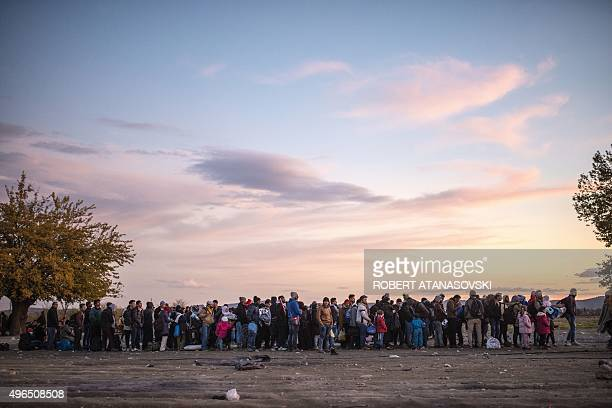 Migrants and refugees walk to catch a bus to Serbia after leaving a registration centre near Gevgelija on November 10 2015 European Union interior...
