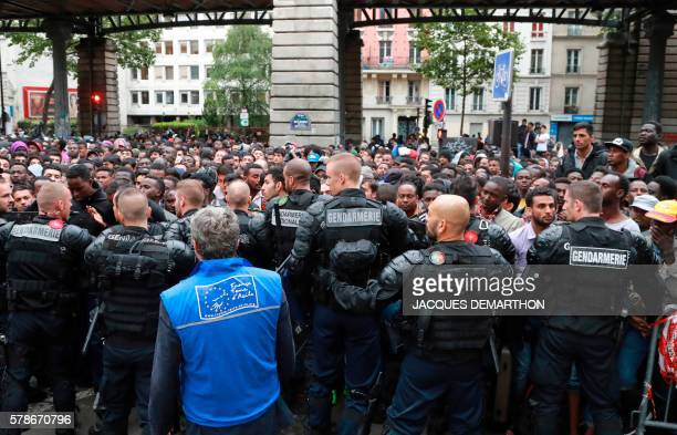 TOPSHOT Migrants are evicted from a makeshift camp by French gendarmes on July 22 2016 in Paris Between 1200 and 1400 people mostly men from Eritrea...