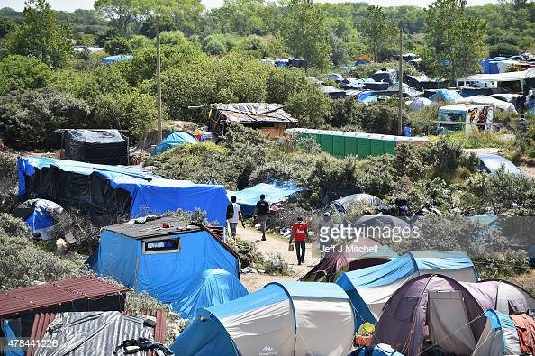 Migrants are seen in a make shift camp known as the 'New Jungle' on June 25 2015 in Calais France Many migrants are camped in Calais on the side of...