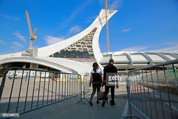 Migrants are seen returning to the Canadian Olympic Stadium that is being used as a shelter on Monday Aug 14 2017 Thousands of people have crossed...