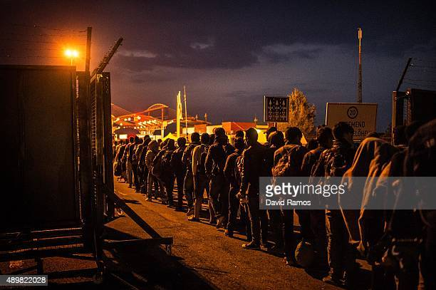 Migrants arrive at a border point between Croatia and Hungary where they will be transported to Austria on September 24 2015 in Baranjsko Petrovo...