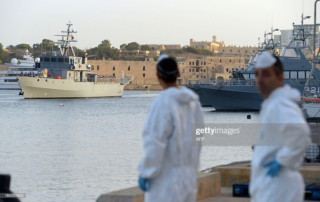 Migrants arrive at Hay Wharf in Valletta aboard a patrol boat of the Armed forces of Malta on October 12, 2013, a day after their boat sank. More than 140 survivors, plucked from the sea after their overloaded boat sank in the latest deadly migrant tragedy to hit the Mediterranean, arrived in Malta. The sinking killed more than 30, most of them women and children, when the boat packed with people desperate to reach European shores went down off Malta near the Italian island of Lampedusa, according to officials.