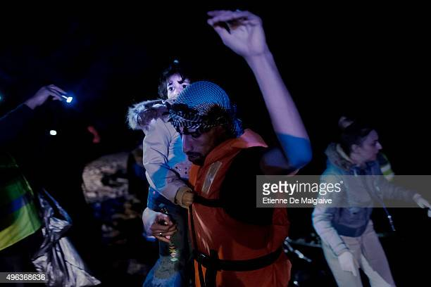 Migrants arrive at night on the shores of Lesbos on November 4 2015 near Skala Sikaminias Greece Lesbos the Greek vacation island in the Aegean Sea...