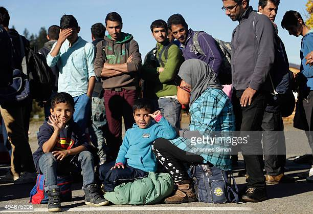 Migrants arrive at the German border to Austria on October 28 2015 near Wegscheid Germany Bavarian Governor Horst Seehofer has accused the Austrian...