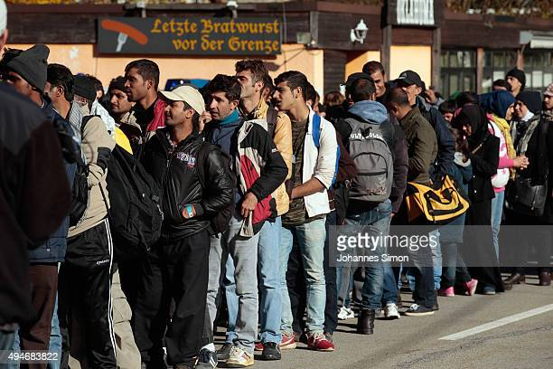 Migrants arrive at the German border to Austria on October 28 2015 near Wegscheid Germany Bavarian Governor Horst Seehofer has accused the Austrian...
